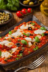 Cod in Italian in tomatoes with olives and capers.