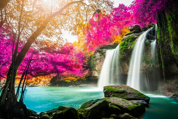 Stores photo Cascade Amazing in nature, beautiful waterfall at colorful autumn forest in fall season