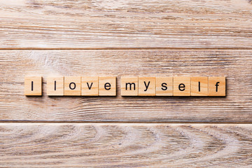 I Love myself word written on wood block. I Love myself text on wooden table for your desing, concept