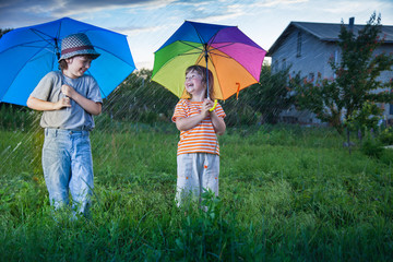 happy brother with umbrella outdoors