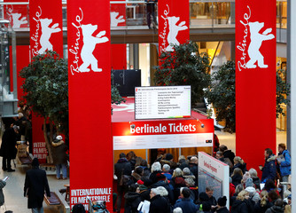 People queue to buy tickets for the upcoming Berlin International Film Festival Berlinale in Berlin