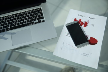 laptop and a smartphone in the workplace businessman