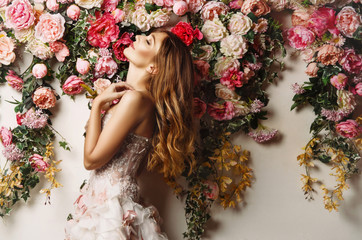 Young beautiful girl at the flower garden Wall mural