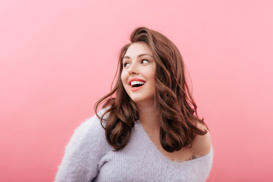 Cheerful plus size model looking away
