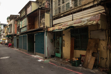 Old run down homes and storefronts during day
