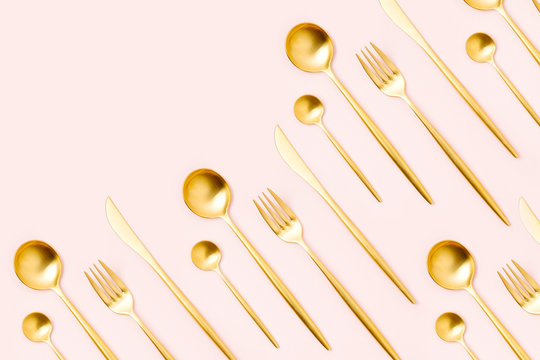 Pattern made of cutlery on pastel background, flat lay, top view. Minimalist concept.