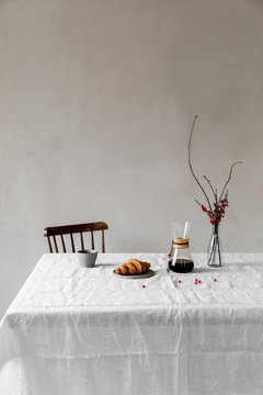 Slow drip coffee and croissant served on the table