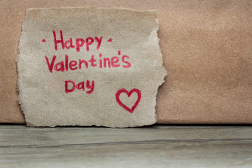 Valentine's Day card handmade on the background of kraft paper
