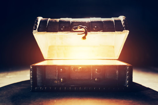 Ancient wooden box with glowing light.