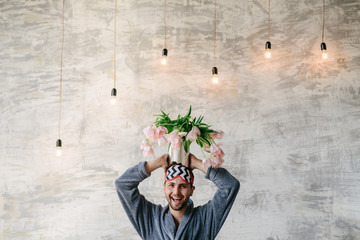 bouquet of tulips in hand on white background close-up. Concept 8 March, international women's day. Valentine's Day. Smart young man at Valentine's day. Concepts. Love - Image