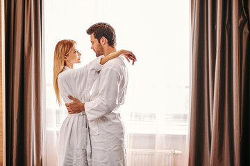 Longtime relationships. Young couple travel together hotel room leisure