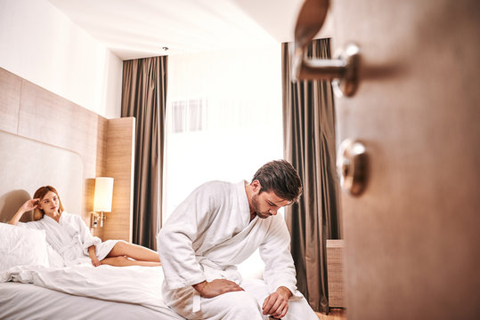 Weakness worried man in hotel room. Man can't make sex with his woman