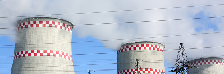 City thermal power plant background of blue sky and wires. Energy production pollutes the environment concept
