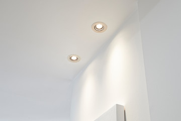 Two spot light illuminated on white ceiling