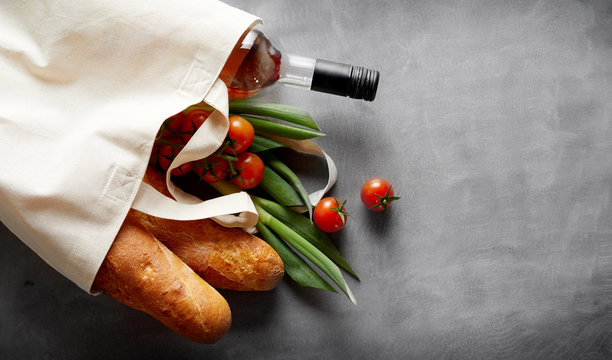 Eco-friendly textile bag with groceries and wine