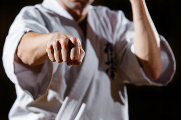 Close up man fist. Anger concept. Self defence training. Attack gesture
