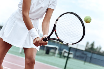 Control the ball. Tennis player is practising her shots