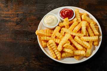 Plate of rippled french fries with copy space