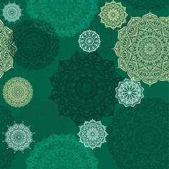 Seamless vector background with lace pattern in dark green colors