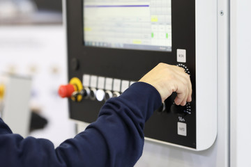 operator controls the work of the CNC machine