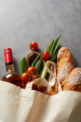 Baguettes, wine and groceries in a fabric bag
