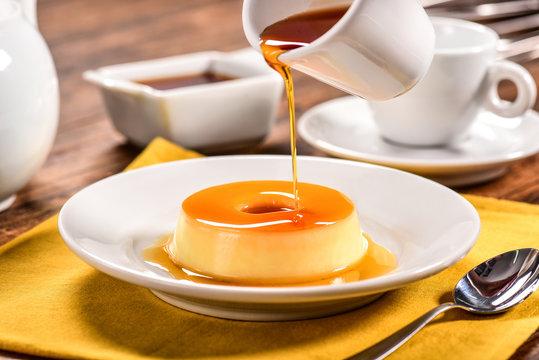 Vanilla pudim with caramel sauce on decorated scene