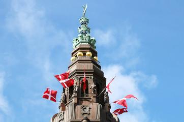 The danish flags on the tower. Christiansborg Palace, Copenhagen, Denmark.