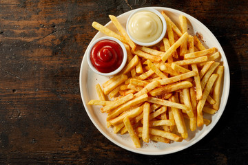 Plate of french fries with sauces with copy space