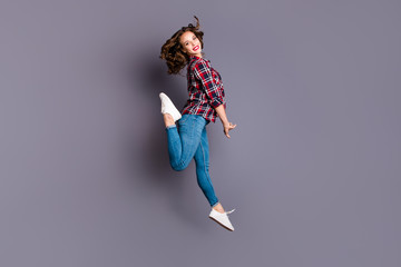 Full length size body view photo jumping high amazing attractive she her lady flight in air coquettish behaviour wearing casual jeans denim checkered plaid shirt grey background
