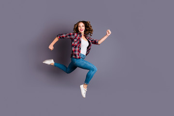 Full length body size view photo fly high beautiful she her girl rushing for black friday sale discount wearing casual checkered plaid shirt jeans denim isolated grey background