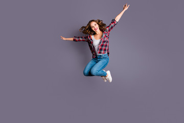 Full length body size view portrait of her she nice attractive adorable sporty lovely charming pretty cheerful cheery wavy-haired lady free time life like plane isolated over gray background