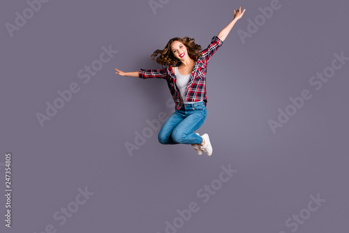 Wall mural Full length body size view portrait of her she nice attractive adorable sporty lovely charming pretty cheerful cheery wavy-haired lady free time life like plane isolated over gray background