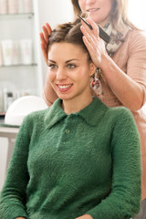 Cute smiling woman in hairstylist salon