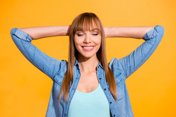 Wall Mural - Portrait of her she nice-looking pretty lovely sweet lovable fascinating attractive cheerful straight-haired lady hands behind head closed eyes isolated over bright vivid shine yellow background