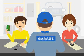 young couple paying the car mechanic's bill