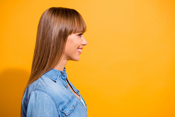 Wall Mural - Close up side profile portrait amazing attractive she her lady confidently look to empty space toothy beaming smile wearing casual jeans denim shirt clothes isolated on yellow background