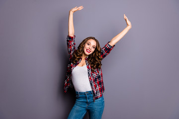 Wall Mural - Portrait of nice-looking attractive charming pretty cheerful cheery wavy-haired lady raising hands up isolated over gray pastel purple background