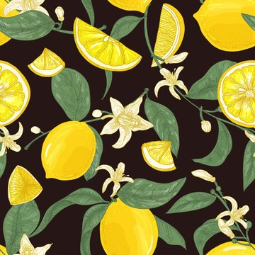 Natural seamless pattern with fresh juicy lemons, whole and cut into pieces, branches with blooming flowers and leaves on black background