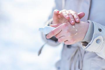 Woman use hand cream on dry hand