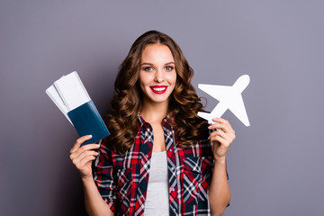 Wall Mural - Portrait of her she nice cute attractive lovely glamorous charming pretty cheerful cheery wavy-haired lady holding pass plane form figure ready isolated over gray background