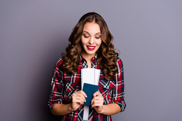 Portrait of her she nice cute winsome attractive lovely charming pretty cheerful wavy-haired lady holding pass passport id ready isolated over gray background