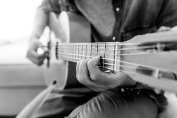 Playing guitar. Acoustic guitar in the hands of the guitarist