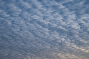 Scenery of cloudy blue sky in the evening. The natural art background and template.