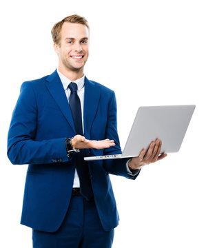Businessman using laptop, isolated