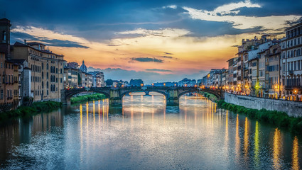 View of the Arno river, evening Florence and the St Trinity Bridge. Florence, Italy.