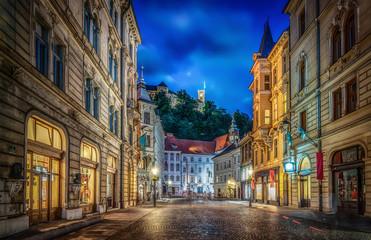 View of the street Stritarjeva, evening city and Ljubljana's castle.  Ljubljana, capital of Slovenia.