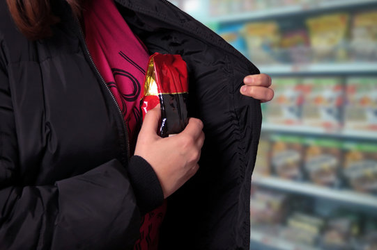 Woman shoplifting in a store