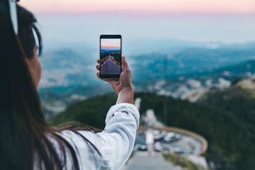 woman taking picture on her phone of view from mausoleum of montenegro ruler