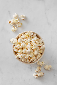 Pop corn bowl viewed from above on a marble background. Top view