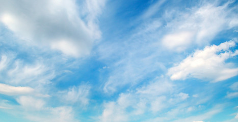 Clouds in the blue sky. Wide photo